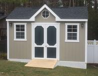 10x16 Gable shed with 7/12 roof pitch, dormer, windows and lattice skirting and SmartSide wood siding built in Virginia by Sheds by Ken