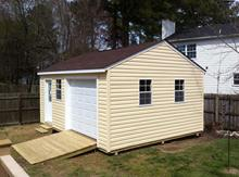 14x20 Gable Garage with 5/12 roof pitch, 9 lite door, windows and vinyl siding in Virginia built by Sheds by Ken.