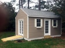 12x16 Gable shed with 7/12 roof pitch, ramp, lattice skirting, window and vinyl siding