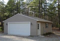 24x28 Gable Garage with 5/12 roof pitch, window, 9 lite door and vinyl siding in Virginia built by Sheds by Ken