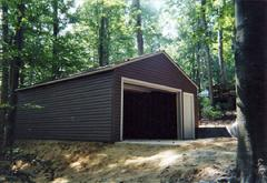 24x28 Gable Garage with 5/12 roof pitch, walk door and vinyl siding in Virginia built by Sheds by Ken