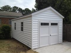 11x20 Gable Garage with doors with transom windows and Beaded vinyl siding in Virginia built by Sheds by Ken
