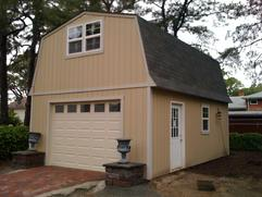 16x24 Barn Garage with 9 lite door, windows and SmartSide wood siding in Virginia built by Sheds by Ken
